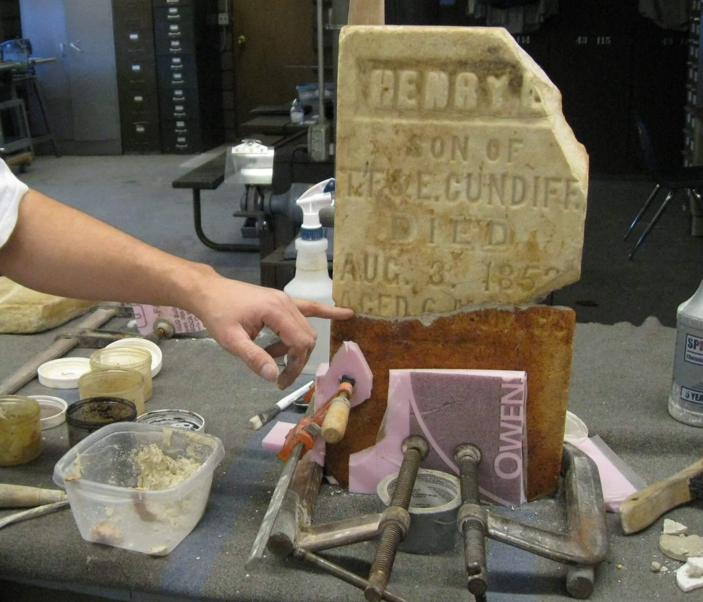 Cemetary Headstone Applying Finish Material